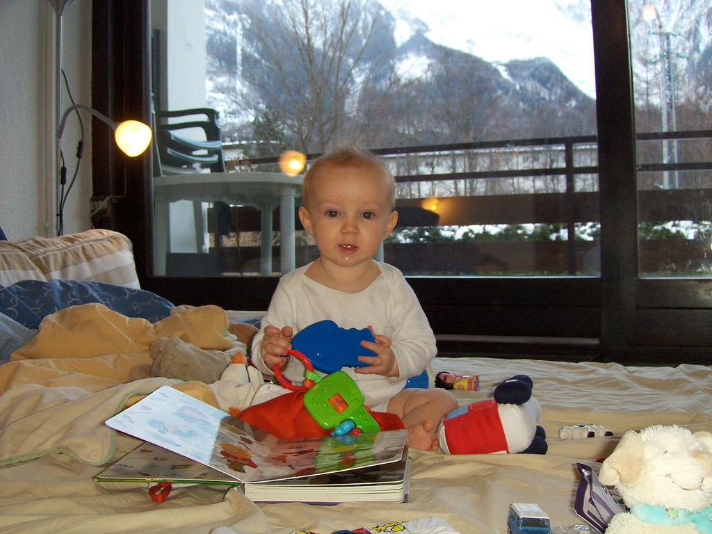 168 Enjoying his Stocking Toys